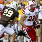 Nebraska finally can set its sights on its first Big Ten Conference game with a trip to Wisconsin next weekend after beating Wyoming. Rex Burkhead (right) rushed for two touchdowns and a career-high 170 yards and quarterback Taylor Martinez added 157 passing yards and another score. The Huskers rolled up 490 yards total offense in their first road game of the season.