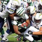 Chargers' linebacker Donald Butler attempts to rip off Shonn Greene's head.