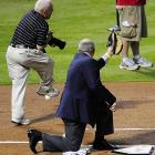 George W. Bush nails MLB photographer Rich Pilling with a ceremonial first pitch that got past Texas Rangers' president Nolan Ryan during game four of the World Series.
