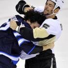 Pittsburgh's Deryk Engelland fights off a hug from Winnipeg's Chris Thorburn.
