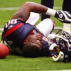 Texans' star receiver Andre Johnson writhes in pain after suffering a hamstring injury against the Steelers.