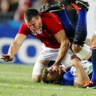 Wales' Sam Warburton tackles France's Vincent Clerc by the face during the Rugby World Cup.