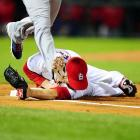 Chris Carpenter dodged Elvis Andrus' cleat, but the St. Louis ace still got a face full of dirt and first base.