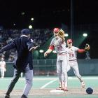 """First base umpire Don Denkinger's ruling in Game 6 of the 1985 World Series is known simply as """"The Call."""" With the Cardinals leading the Royals 3-2 in the series, St. Louis took a 1-0 advantage into the bottom of the ninth inning. Cardinals reliever Todd Worrell induced a slow roller to first base from the Royals' Jorge Orta leading off in the ninth, and an underhand toss from first baseman Jack Clark to Worrell, who was covering the bag, looked like a sure out. Denkinger called Orta safe, though replays clearly showed he was out. The dubious single ignited a two-run Royals rally that won the game. Kansas City rolled to an 11-0 win the next night in Game 7 to win its first World Series title."""