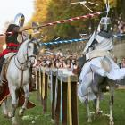 Surely they joust. Actors dressed as El Cid, the hero of medieval Spain, battle in downtown Burgos. Not to worry about the knight on the right. It's only a flesh wound.
