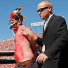 Carried away by his zeal and reportedly a bit too much firewater, this dignified partisan with the distinctive headdress, body paint and broken sunglasses was escorted off the field by a clearly unamused security agent during Kansas City's rousing 22-17 triumph over Minnesota at Arrowhead Stadium.