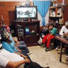 "Estrella Dorada (that's Spanish for ""Golden Star"") and her four sons gather for a family viewing of the Jack Black comedy classic  Nacho Libre  at their home on the outskirts of Mexico City.  Fun Fact to Know & Tell:  Estella Dorada married a wrestler and they had three baby wrestlers that are now all growed up, as you can see. The fourth boy appears to have been adopted."