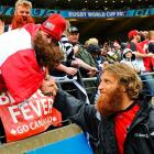 Their playoff beards fully grown, flanker Adam Kleeberger of Canada exchanged a hearty handclasp with a fan after his team's agonizingly narrow 79-15 loss and exit from the competition in Wellington, New Zealand.