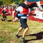 Sports imitates life: Rocco Andreozzi and Kim Wasko (right) stagger across the finish line as David and Lacey Castro (left) collapse from the rigors of a 278-yard obstacle course that approximates the great institution of Holy Headlock in all its grueling glory, expecially the infamous water trap known as the 'Widow Maker.'