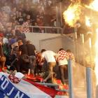 In other sports news from the cradle of the Olympics, Croatian fans had a hot time at their team's match (which someone struck, igniting the drapes) against Greece at Karaiskaki stadium near Athens.
