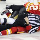 With the NHL under fire for its epidemic of ugly physical violence, linesman Don Henderson, Flames forwards Lee Stempniak and Curtis Glencross and Penguins defenseman Zbynek Michalek formed an impromptu lovepile to lighten the mood a bit.