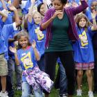 The First Lady is clearly horrified to find the South Lawn of her house overrun by unruly urchins trying to break the Guinness World Record for the most people doing jumping jacks in a 24-hour period.