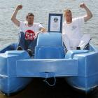 """Former England cricketer Andrew """"Freddie"""" Flintoff (right) and friend Steve Harmison celebrate with their official certificate after a successful attempt to break the fastest 100m in a pedalo world record on Hyde Park boating lake in London."""
