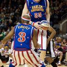"""Paul (Tiny) Sturgess, standing 7' 8"""", is not only the tallest Harlem Globetrotter but also the tallest person to ever play professional basketball."""