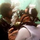 Ewa and Pawel Jaworzno of Poland kiss during the largest underwater wedding. There were 275 wedding guests.
