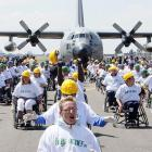 Eighty-four wheelchair-bound Belgians pull a 67-ton C130 cargo aircraft over 100 meters.
