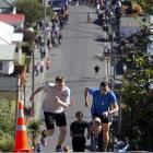 Glen Ballam (right) and Nick Abraham race up a 19-degree slope on Baldwin street in Dunedin, New Zealand.
