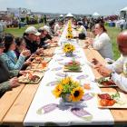 Guests who wanted to try some of Safeway's Open Nature Line of 100 percent natural foods in San Francisco enjoyed the free barbecue at a table that stretched 305 feet.