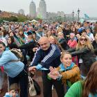 Fifteen thousand people take part in a mass morning gym exercise in Kiev to set a new Guinness world record of the most amount of people taking part in a morning gym exercise.