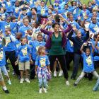 """First Lady Michelle Obama led more than 20,000 children worldwide in a jumping jacks exercise to promote her """"Let's Move"""" campaign. On Oct. 12, at 3 p.m., Guinness confirmed that she had helped break the record for most people performing jumping jacks in a 24-hour period."""