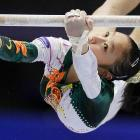 Huang Qiushuang of China competes on the unevern bars during the Artistic Gymnastics World Championships in Tokyo.