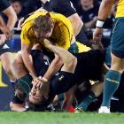 Rocky Elsom of the Australia Wallabies performs chest compressions on the face of New Zealand All Blacks' Conrad Smith during the Rugby World Cup semifinals. Smith would get the last laugh, New Zealand defeated Australia and will play France in the Rugby World Cup final.