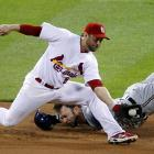 Mark Kotsay dives face first toward second base against the St. Louis Cardinals. Nick Punto tagged out Kotsay and helped St. Louis reach the World Series.
