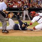 Jerry Hairston Jr. slides just ahead of a throw to Yadier Molina of the Cardinals. The Brewers won 4-2 in Game 4, but lost the NLCS series in six games.