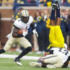 Boilermakers safety Albert Evans' tackles is too late as Michigan's Fitzgerald Toussaint falls into the end zone for one of his two touchdowns during the Wolverines' 36-14 victory.