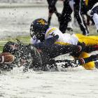 West Virginia defensive back Pat Miller hits Rutgers receiver Quran Pratt, causing the pass to fall to the snow during the Big East contest. The Mountaineers won 41-31.