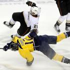 Anaheim defenseman Francois Beauchemin and Nashville center Mike Fisher find out that ice is slippery in the first period of the Predators' 3-0 victory.