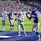 Mario Manningham hauls in a touchdown from Eli Manning during the Giants 20-17 comeback win over Miami.