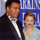Madonna and Muhammad Ali attend the Parkinson's Disease Foundation's annual dinner in 1995.