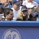 Madonna enjoys her seat along the third base line during a 2008 Reds-Yankees game at Yankee Stadium.