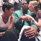 Madonna takes in Game 4 of the 1994 NBA Finals with Magic Johnson and friend Ingrid Casares.