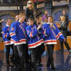 """Madonna enters a 2009 taping of  Late Show with David Letterman  while riding on the hockey sticks of the New York Rangers, who delivered the """"Top Ten List"""" for the broadcast."""
