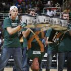 The Michigan State marching band's drumline performs before the team's  Midnight Madness scrimmage.