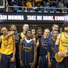"""West Virginia's Deniz Kilicli leads his Mountaineer teammates in singing """"Country Roads"""" during NCAA college basketball Mountaineer Madness at WVU Coliseum."""