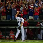 Rangers starter Derek Holland tried to talk manager Ron Washington into leaving him in the game after issuing a one-out walk in the ninth, then left to a standing ovation from the Texas crowd.