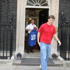 Giants' quarterback Eli Manning escapes from Gordon Brown's office, but was forced to leave his jersey and game ball with the British Prime Minister.