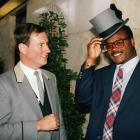 Unable to find a British police hat, Singletary borrows the next best thing, a top hat from a hotel doorman.