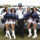 New England cheerleaders make friends with local law enforcement in London.