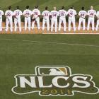 St. Louis lines up for an NLCS game against the Milwaukee Brewers. The Cardinals won the series in six games to clinch a World Series berth. The team has won 10 of the 18 World Series they've played in.
