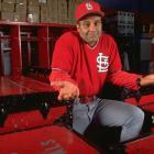 Joe Torre doesn't seem to know why he's alone in the locker room during this 1995 photo shoot. Torre played for the Cardinals from 1969 to 1974 and won the 1971 NL MVP. He was less successful during his six seasons as a St. Louis manager, when the Cardinals never made the playoffs.