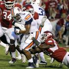 Auburn's Michael Dyer got his yards (112 on 21 carries), but Arkansas got the win. Tyler Wilson, who set a school record with 510 yards passing last week, added 262 more, completing 19 straight passes at one point. Joe Adams had a 92-yard touchdown run on Arkansas' first play of the second half to push the lead to 28-14.