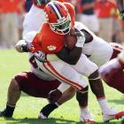 The season's biggest surprise improved to 6-0 by beating Boston College, and freshman phenom Sammy Watkins had another big day, hauling in seven catches for 152 yards. But it wasn't all good, as breakout star quarterback Tajh Boyd was carted off with a left leg injury in the second half. Clemson is awaiting word on the severity of the injury.