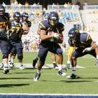 Another slow start, another win for West Virginia. The Mountaineers struggled to a 10-9 halftime lead, but Geno Smith threw for 450 yards and four touchdowns and Week 5 breakout star Dustin Garrison (pictured) added 80 rush yards and a score.