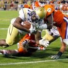Junior Tevin Washington rushed for 176 yards and broke the two longest runs of his career, leading Georgia Tech to an upset of Clemson and likely snuffing out the Tigers' national title hopes. Orwin Smith (shown) added two short rushing tochdowns for the Yellow Jackets,  who snapped a two-game losing streak.