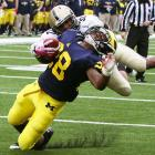 Purdue was riding high after its Week 8 upset of Illinois. Unfortunately, Purdue was also catching Michigan coming off a bye week. Denard Robinson had a poor day through the air, completing just nine passes for 170 yards, no touchdowns and a pick, but he got plenty of help from his ground game. Fitzgerald Toussaint (pictured) carried 20 times for 170 yards and two touchdowns to lead the Wolverines to a 7-1 mark.