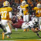 South Carolina's offense may not look as pretty without star running back Marcus Lattimore. It still managed to get the job done. Connor Shaw (14) threw for one touchdown and ran for another, and Brandon Wilds ran for 137 yards as South Carolina survived Tennessee to stay in control of the SEC East.
